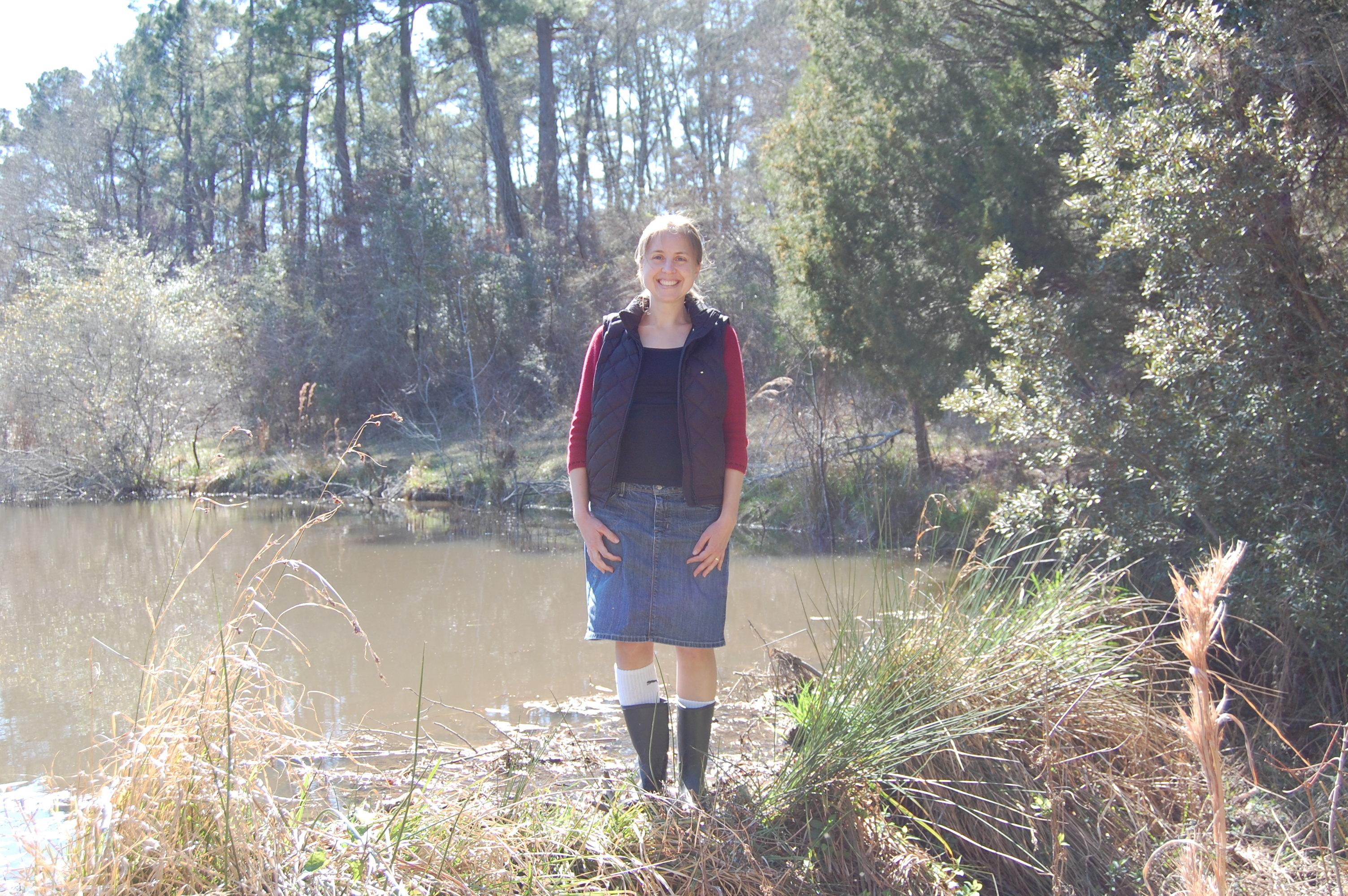 Angela standing on the beaver dam