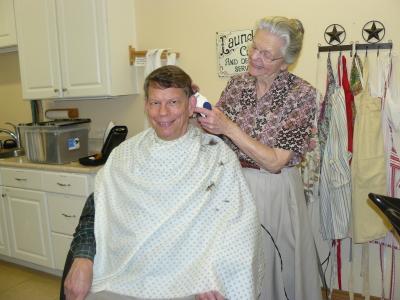 Leona cutting Kens hair